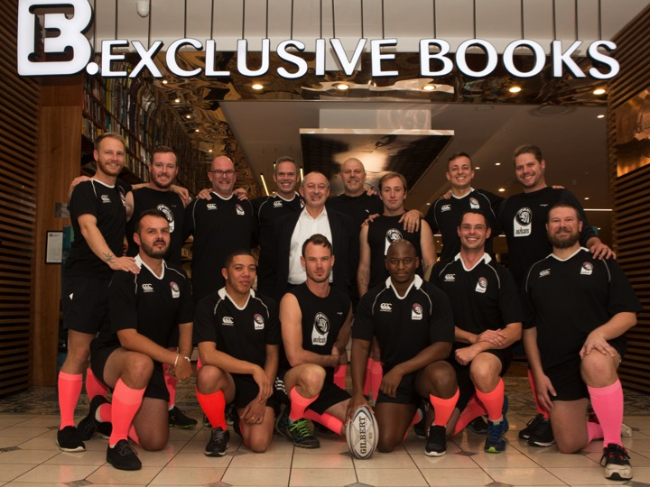 Exclusive Books CEO Benjamin Trisk (centre) with the Exclusive Books Jozi Cats Rugby Club