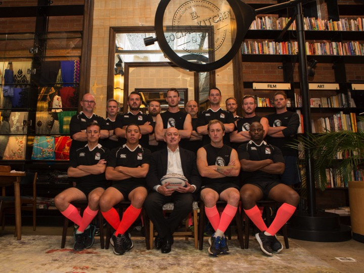 Exclusive Books CEO Benjamin Trisk (seated) with the Exclusive Books Jozi Cats Rugby Club